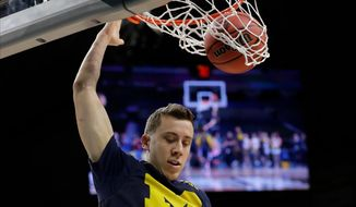 Michigan's Duncan Robinson (22)shoots during a practice session for the Final Four NCAA college basketball tournament, Friday, March 30, 2018, in San Antonio. (AP Photo/Eric Gay)