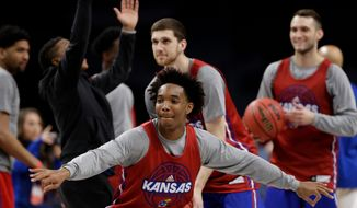 Kansas guard Devonte' Graham participates on a drill during a practice session for the Final Four NCAA college basketball tournament, Friday, March 30, 2018, in San Antonio. (AP Photo/Eric Gay)