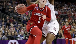 Louisville's Sam Fuehring (3) heads to the basket past Mississippi State's Teaira McCowan (15) during the first half in the semifinals of the women's NCAA Final Four college basketball tournament, Friday, March 30, 2018, in Columbus, Ohio. (AP Photo/Tony Dejak)