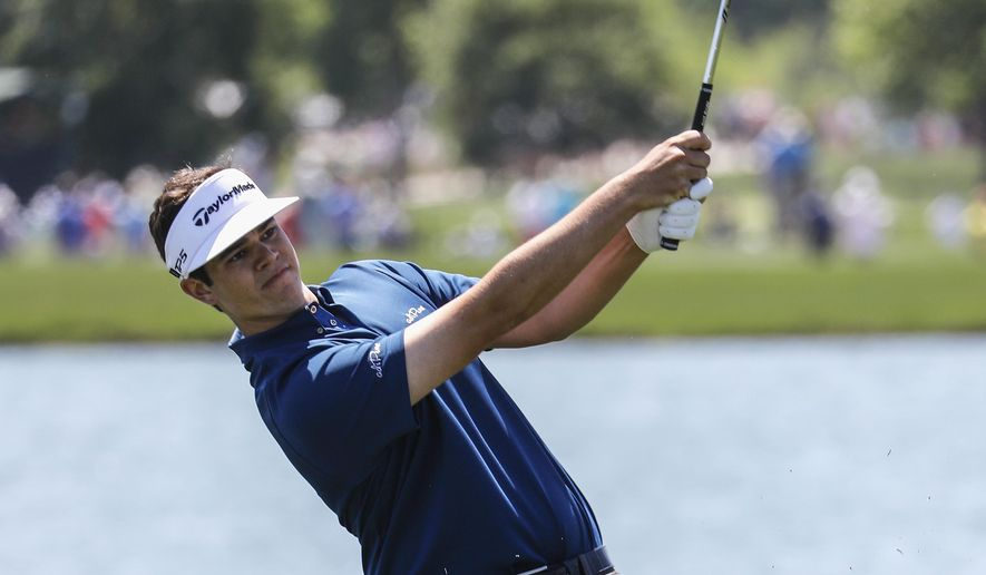 Beau Hossler hits an approach shot on the 18th fairway during the second round of the Houston Open at the Golf Club of Houston on Friday, March 30, 2018. (Tim Warner /Houston Chronicle via AP)