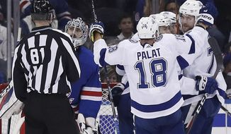 Tampa Bay Lightning left wing Alex Killorn (17) celebrates with teammates after scoring a goal against New York Rangers goaltender Ondrej Pavelec (31) during the second period of an NHL hockey game, Friday, March 30, 2018, in New York. (AP Photo/Julie Jacobson)