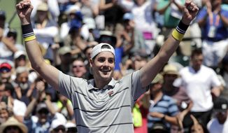 John Isner celebrates after defeating Juan Martin del Potro, of Argentina, 6-1, 7-6 (2) in a semifinal match at the Miami Open tennis tournament, Friday, March 30, 2018, in Key Biscayne, Fla. (AP Photo/Lynne Sladky)