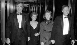 "FILE - In this Oct. 12, 1988 file photo, Vince Foster, left, walks with his wife and then Gov. Bill Clinton and his wife Hillary Rodham Clinton, in Little Rock, Ark. No new autopsy was performed on former White House deputy counsel Vince Foster at a U.S. Navy hospital in Virginia, despite the claim of an online story that experts there found evidence of a homicide. The story from usapoliticstoday claimed Foster's body was exhumed and examined at ""the Naval Hospital in Norfolk, Virginia."" The article also alleged there was no autopsy when Foster died in 1993. (The Northwest Arkansas Democrat-Gazette via AP, File)"