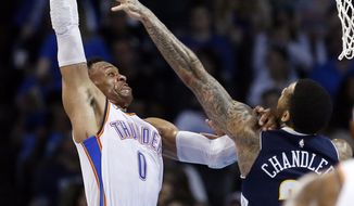 Oklahoma City Thunder guard Russell Westbrook (0) is fouled by Denver Nuggets forward Wilson Chandler, right, as he shoots in the first half of an NBA basketball game in Oklahoma City, Friday, March 30, 2018. (AP Photo/Sue Ogrocki)
