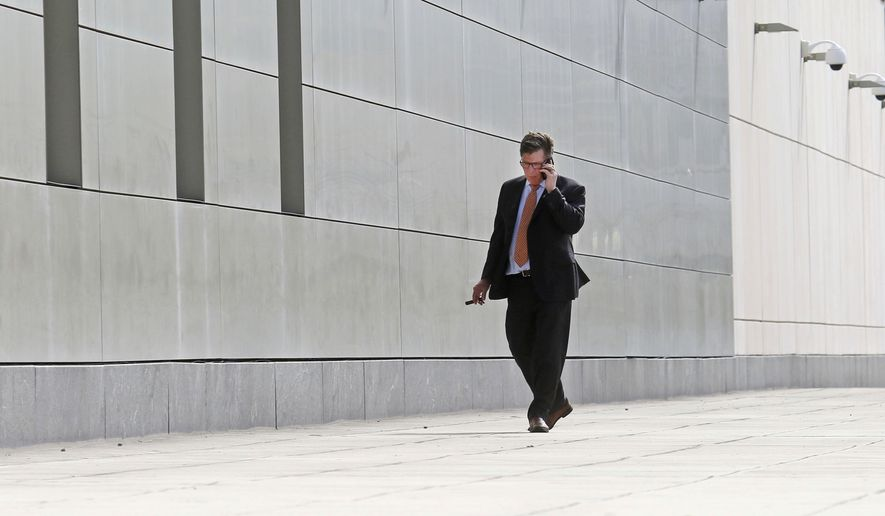 Charles Swift, defense attorney for Noor Salman paces outside the Orlando Federal Courthouse, Thursday, March 29, 2018, as the jury deliberates the fate of his client in Orlando, Fla. Jurors in the trial of Salman, accused of aiding her husband's terrorist attack against an Orlando nightclub, later finished deliberating on Thursday without reaching a verdict. (Red Huber/Orlando Sentinel via AP)