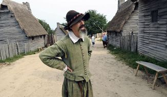 FILE - In this Sept. 9, 2008 file photo, an employee of Plimoth Plantation portrays Edward Winslow at Plimoth Plantation's 1627 English Village, in Plymouth, Mass. Actors who portray the Pilgrims, along with other unionized employees, are back on the picket line in 2018, demanding better pay and benefits. (AP Photo/Lisa Poole, File)