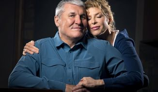 In this Monday March 26, 2018 photo, former Super Bowl MVP and Shadle Park High graduate Mark Rypien poses with his wife Danielle, in Spokane, Wash. With the help of his wife Rypien is dealing with a traumatic brain injury caused by the many concussions he received during his football career. (Colin Mulvany /The Spokesman-Review via AP) ** FILE **