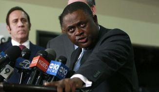 Pathologist, Dr. Bennet Omalu, discusses the results of the autopsy he conducted on police shooting victim Stephon Clark, during a news conference, Friday, March 30, 2018, in Sacramento, Calif. Omalu, who was hired by the family to conduct an independent autopsy, said Clark was shot seven times from behind and took up to 10 minutes to die. (AP Photo/Rich Pedroncelli)