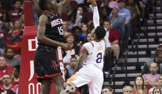 Phoenix Suns guard Tyler Ulis (8) puts a shot over Houston Rockets center Clint Capela (15) in the first half of an NBA basketball game Friday, March 30, 2018, in Houston. (AP Photo/George Bridges)