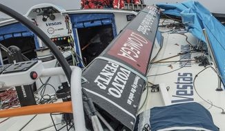 This Friday, March, 30, 2018 photo provided by Volvo Ocean Race shows the crew of Vestas 11th Hour Racing dismasted, approximately 100 miles southeast of the Falkland Islands in the Atlantic Ocean. It was the third major setback to a team this week in the bluewater classic. Vestas 11th Hour Racing, a joint American-Danish team, reported its mast broke just above the first spreader while the sloop was sailing in 25-30 knots of wind and 10-foot (3-meter) waves. (Jeremie Lecaudey/Volvo Ocean Race via AP)