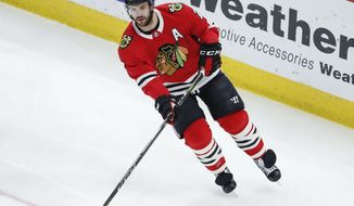 Chicago Blackhawks defenseman Brent Seabrook looks to pass the puck against the Winnipeg Jets during the first period of an NHL hockey game Thursday, March 29, 2018, in Chicago. (AP Photo/Kamil Krzaczynski)