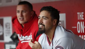 Washington Nationals third baseman Anthony Rendon sits in the dugout in the eighth inning of a baseball game against the Cincinnati Reds, Saturday, March 31, 2018, in Cincinnati. (AP Photo/John Minchillo)