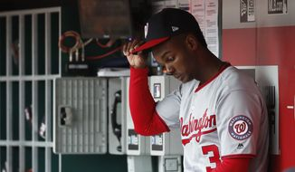 Washington Nationals center fielder Michael A. Taylor sits in the dugout in the eighth inning of a baseball game against the Cincinnati Reds, Saturday, March 31, 2018, in Cincinnati. (AP Photo/John Minchillo) **FILE**