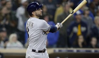 Milwaukee Brewers' Ryan Braun hits a 3-run home run against the San Diego Padres during the ninth inning of a baseball game in San Diego, Friday, March 30, 2018. The Brewers won 8-6. (AP Photo/Alex Gallardo)