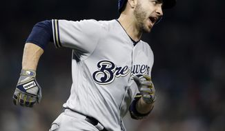 Milwaukee Brewers' Ryan Braun reacts rounding first as he hits a 3-run home run against the San Diego Padres during the ninth inning of a baseball game in San Diego, Friday, March 30, 2018. The Brewers won 8-6. (AP Photo/Alex Gallardo)