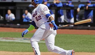New York Mets' Yoenis Cespedes (52) follows through for a home run in the fifth inning of a baseball game against the St. Louis Cardinals, Saturday, March 31, 2018, in New York. (AP Photo/Frank Franklin II)