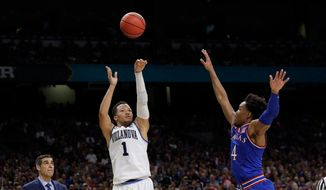 Villanova's Jalen Brunson (1) shoots a 3-point basket against Kansas's Devonte' Graham (4) during the second half in the semifinals of the Final Four NCAA college basketball tournament, Saturday, March 31, 2018, in San Antonio. (AP Photo/David J. Phillip)