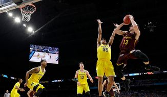 Loyola-Chicago guard Clayton Custer (13) shoots over Michigan guard Eli Brooks (55) during the first half in the semifinals of the Final Four NCAA college basketball tournament, Saturday, March 31, 2018, in San Antonio. (AP Photo/David J. Phillip) **FILE**