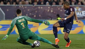 PSG's Kylian Mbappe, right, faces Monaco's goalkeeper Danijel Subasic during the League Cup final soccer match between Paris Saint Germain and Monaco in Bordeaux, southwestern France, Saturday, March 31, 2018. (AP Photo/Thibault Camus)
