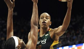 FILE - In this July 1, 2012, file photo, Seattle Storm's Tina Thompson, right drives to the basket against Connecticut Sun's Asjha Jones during the second half of a WNBA basketball game in Uncasville, Conn. Thompson is among the 13-member class that will be inducted into the Basketball Hall of Fame in September, the Hall of Fame announced Saturday, March 31, 2018.   (AP Photo/Jessica Hill, File) **FILE**