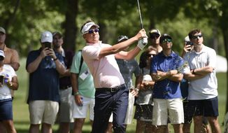 Ian Poulter hits his third shot on the 13th hole during the third round of the Houston Open golf tournament, Saturday, March 31, 2018, in Humble, Texas. (AP Photo/Eric Christian Smith)