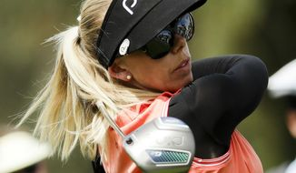 Pernilla Lindberg, of Sweden, watches her tee shot on the second hole during the third round of the LPGA Tour ANA Inspiration golf tournament at Mission Hills Country Club, Saturday, March 31, 2018, in Rancho Mirage, Calif. (AP Photo/Chris Carlson)