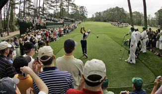 FILE - In this April 4, 2007 file photo Sergio Garcia of Spain hits a tee shot on the 14th hole during practice for the 2007 Masters golf tournament at the Augusta National Golf Club in Augusta, Ga. Garcia made a crucial birdie on the 14th hole when he rallied to win the Masters last year. (AP Photo/Rob Carr, file)