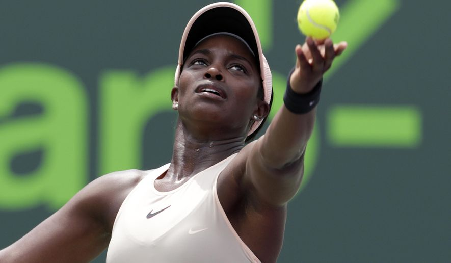 Sloane Stephens serves to Jelena Ostapenko, of Latvia, during the final at the Miami Open tennis tournament, Saturday, March 31, 2018, in Key Biscayne, Fla. (AP Photo/Lynne Sladky)
