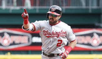 Washington Nationals' Adam Eaton runs the bases after hitting a solo home run off Cincinnati Reds relief pitcher Austin Brice in the seventh inning of a baseball game, Saturday, March 31, 2018, in Cincinnati. (AP Photo/John Minchillo)