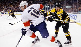 Boston Bruins' Torey Krug (47) defends against Florida Panthers' Aleksander Barkov (16), of Finland, during the first period of an NHL hockey game in Boston, Saturday, March 31, 2018. (AP Photo/Michael Dwyer)