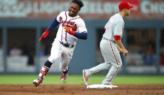 Atlanta Braves' Ozhaino Albies rounds second for a triple in the first inning of a baseball game against the Philadelphia Phillies, Saturday, March 31, 2018, in Atlanta. (AP Photo/Todd Kirkland)