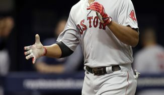 Boston Red Sox's Xander Bogaerts reacts as he runs around the bases after his home run off Tampa Bay Rays pitcher Andrew Kittredge during the second inning of a baseball game Saturday, March 31, 2018, in St. Petersburg, Fla. (AP Photo/Chris O'Meara)