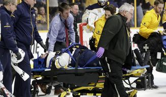 Buffalo Sabres defenseman Victor Antipin, of Kazakhstan, is taken off the ice after being checked into the boards by Nashville Predators left wing Scott Hartnell in the second period of an NHL hockey game Saturday, March 31, 2018, in Nashville, Tenn. Hartnell was given a game misconduct penalty for boarding. (AP Photo/Mark Humphrey)