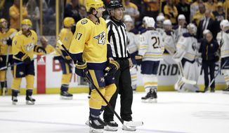 Nashville Predators left wing Scott Hartnell (17) is led to the penalty box after Hartnell checked Buffalo Sabres defenseman Victor Antipin, of Kazakhstan, into the boards in the second period of an NHL hockey game Saturday, March 31, 2018, in Nashville, Tenn. Hartnell was given a game misconduct penalty for boarding and Antipin was taken off the ice on a stretcher. (AP Photo/Mark Humphrey)