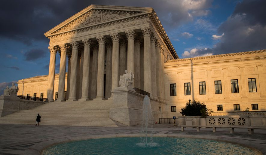 In this Oct. 10, 2017 photo, the Supreme Court in Washington is seen at sunset.    (AP Photo/J. Scott Applewhite) **FILE**