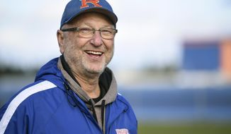 In this Monday, Feb. 26, 2018 photo Ridgefield softball coach Dusty Anchors is pictured on the softball field during tryouts at Ridgefield High School, in Ridgefield, Wash. (Ariane Kunze /The Columbian via AP)