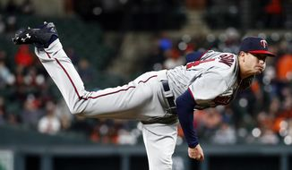 Minnesota Twins starting pitcher Kyle Gibson follows through on a pitch to the Baltimore Orioles in the third inning of a baseball game, Saturday, March 31, 2018, in Baltimore. (AP Photo/Patrick Semansky)