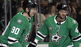 Dallas Stars' Jason Spezza (90) and Alexander Radulov (47) celebrate a goal by Spezza in the first period of an NHL hockey game against the Minnesota Wild in Dallas, Saturday, March 31, 2018. (AP Photo/Tony Gutierrez)