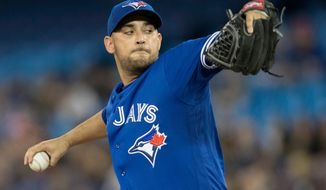 Toronto Blue Jays starting pitcher Marco Estrada throws against the New York Yankees during the first inning of a baseball game in Toronto on Saturday, March 31, 2018. (Fred Thornhill/The Canadian Press via AP)