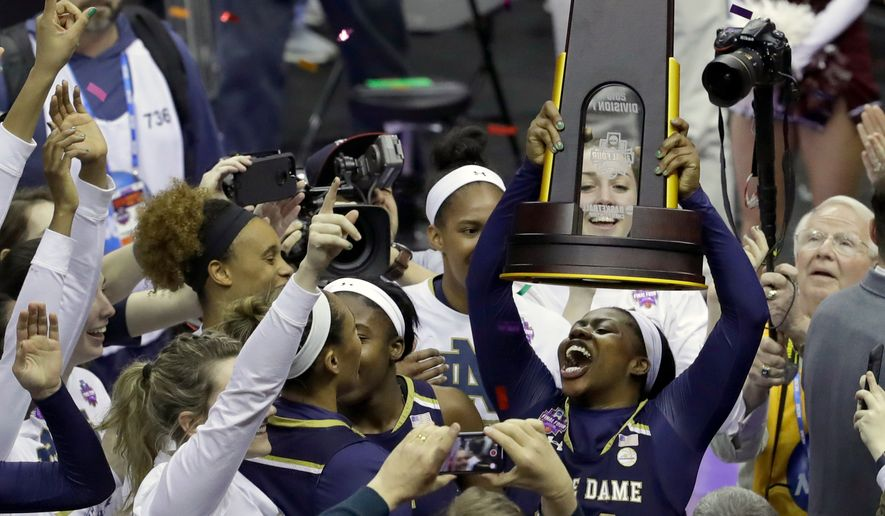 Notre Dame's Arike Ogunbowale holds the trophy after defeating Mississippi State in the final of the women's NCAA Final Four college basketball tournament, Sunday, April 1, 2018, in Columbus, Ohio. Notre Dame won 61-58. (AP Photo/Darron Cummings) **FILE**