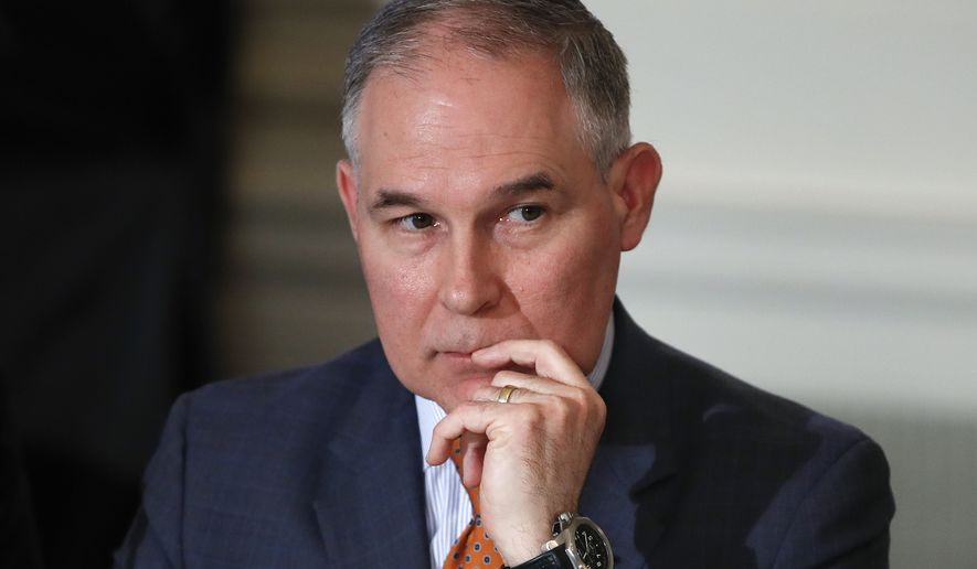 In this Feb. 12, 2018 photo, Environmental Protection Agency Administrator Scott Pruitt attends a meeting with state and local officials and President Donald Trump about infrastructure in the State Dining Room of the White House in Washington.  Senate Democrats are pressing Pruitt on whether a key member of his security team improperly steered a government contract to a personal business associate. (AP Photo/Carolyn Kaster)