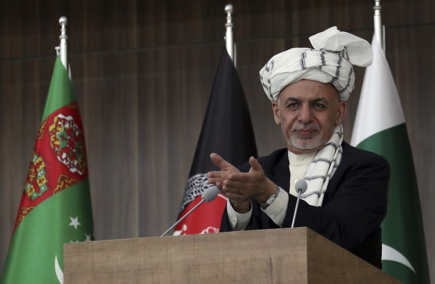 In this Feb. 23, 2018, file photo, Afghanistan's President Ashraf Ghani speaks during the integration ceremony of TAPI pipeline in Herat, Afghanistan. (AP Photo/Hamed Sarfarazi, File)