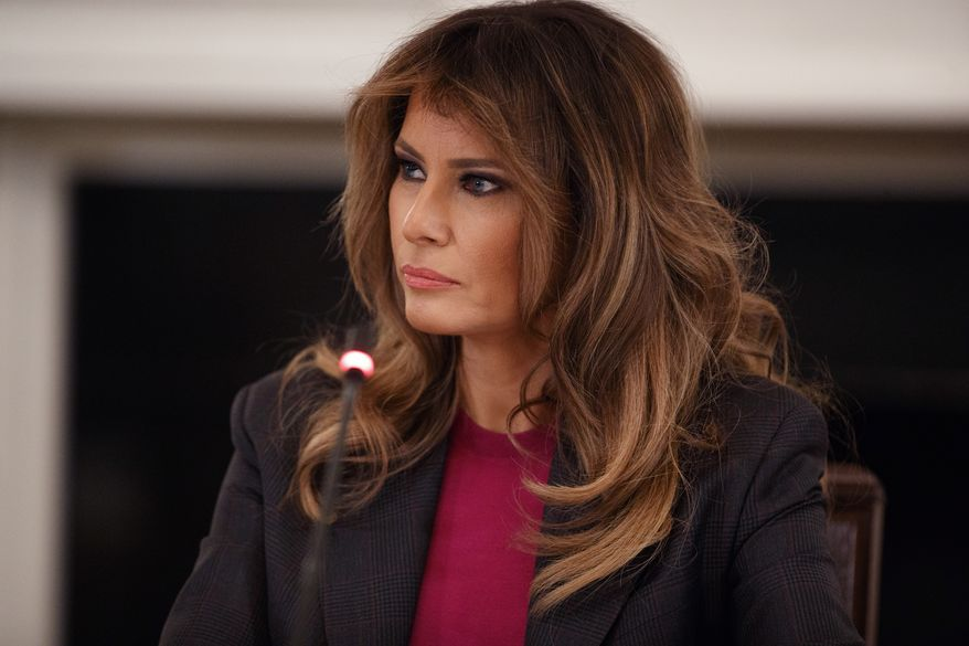 First lady Melania Trump listens during a roundtable on cyberbullying in the State Dining Room of the White House, Tuesday, March 20, 2018, in Washington. (AP Photo/Evan Vucci)