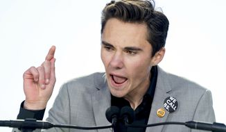 """""""I'm glad to see corporate America standing with me and the other students of Parkland and everybody else. Because when we work together we can accomplish anything,"""" David Hogg said. (Associated Press)"""