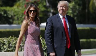 President Donald Trump and first lady Melania Trump arrive for Easter services at Episcopal Church of Bethesda-by-the-Sea in Palm Beach, Fla., Sunday, April 1, 2018. (AP Photo/Pablo Martinez Monsivais)
