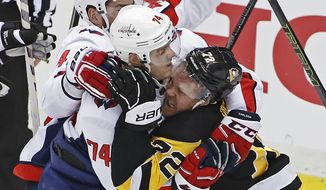 Pittsburgh Penguins' Patric Hornqvist (72) and Washington Capitals' John Carlson (74) tangle as Tom Wilson, rear, joins the scuffle during the third period of an NHL hockey game in Pittsburgh, Sunday, April 1, 2018. Hornqvist was penalized for the fracas. The Capitals won 3-1. (AP Photo/Gene J. Puskar) **FILE**