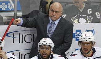Washington Capitals coach Barry Trotz gives instructions during the third period of the team's NHL hockey game against the Pittsburgh Penguins in Pittsburgh, Sunday, April 1, 2018. The Capitals won 3-1. (AP Photo/Gene J. Puskar) **FILE**