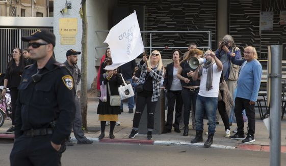 Right-wing Israelis demonstrate across from a left-wing demonstration for Gaza in Tel Aviv, Israel, Sunday, April 1, 2018. Israel's defense minister on Sunday rejected international calls for an investigation into deadly violence along Gaza's border with Israel, saying troops acted appropriately and fired only at Palestinian protesters who posed a threat. But video from the scene showed at least a handful of incidents in which people appear to have been shot either far from the border or while they were not actively rioting. (AP Photo/Sebastian Scheiner)