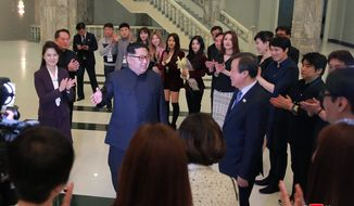 "In this photo provided by the North Korean government, North Korean leader Kim Jong Un, center left, talks with South Korean Culture, Sports and Tourism Minister Do Jong-whan, center right, as his wife Ri Sol Ju, left, claps during a visit to members of a South Korean artistic group after their performance in Pyongyang, North Korea, Sunday, April 1, 2018. Kim clapped his hands as he, along with his wife and hundreds of other citizens, watched the rare performance Sunday by South Korean pop stars visiting Pyongyang, highlighting the thawing ties between the rivals after years of heightened tensions over the North's nuclear program. Independent journalists were not given access to cover the event depicted in this image distributed by the North Korean government. The content of this image is as provided and cannot be independently verified. Korean language watermark on image as provided by source reads: ""KCNA"" which is the abbreviation for Korean Central News Agency.  (Korean Central News Agency/Korea News Service via AP)"