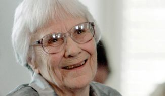 FILE - In this Aug. 20, 2007, file photo, author Harper Lee smiles during a ceremony honoring the four new members of the Alabama Academy of Honor at the Capitol in Montgomery, Ala. Six letters donated to Emory University and being made public Monday, April 2, 2018, show the author lamenting the conservative values of her native Monroeville, Alabama, and longing to back in New York. They also reflect her deep compassion for her father, A.C. Lee, the basis for the famous fictional lawyer Atticus Finch. (AP Photo/Rob Carr, File)